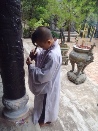 Buddhist monk teaching me prayer ritual, vietnam